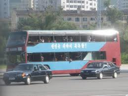 26 A double-decker bus in Pyongyang! And there's a Mercedes-Benz car too!