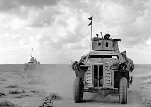 1941 Marmon-Herrington armoured cars on patrol in the Western Desert, 28 November 1941.