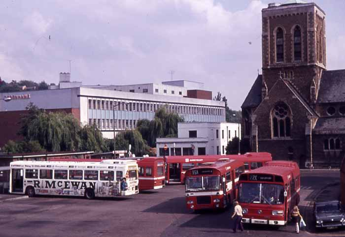 Nationals are seen with a Marshall bodied Bristol RE in Guildford Bus Station