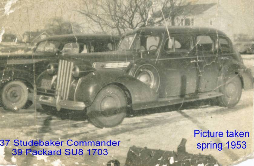 1937 Studebaker behind 1939 Packard super 8