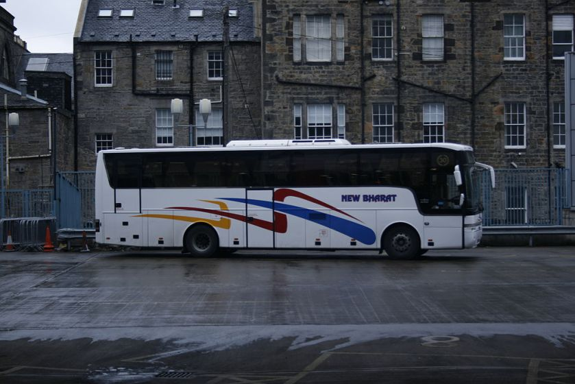 A Van Hool-bodied B12M of New Bharat Coaches stands at Edinburgh bus station
