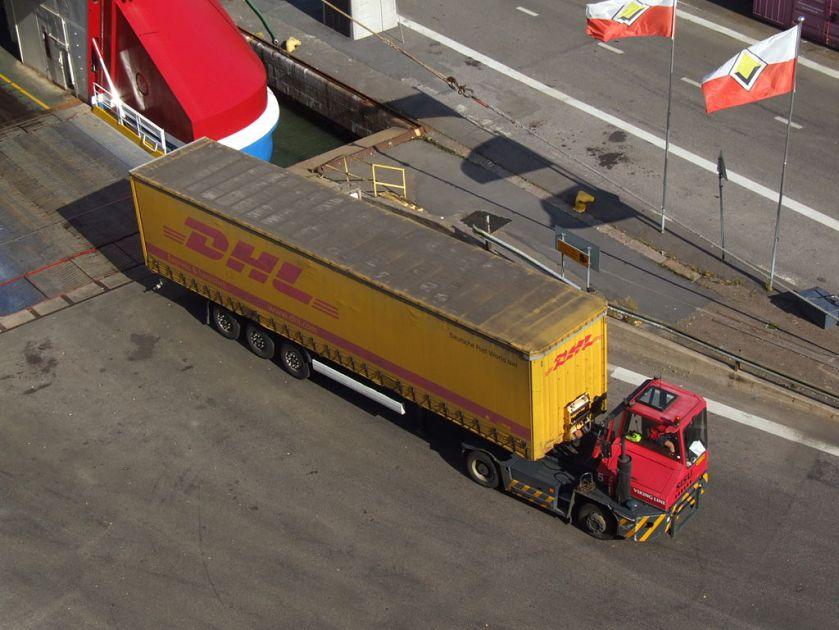 SISU terminal tractor DHL semi-trailer unloaded from ferry
