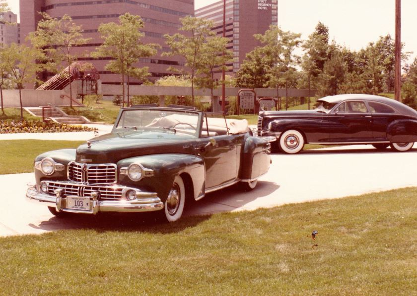 1948 Lincoln Continental Cabriolet, Esmeralda, alongside a 1947 Packard Custom Super Clipper