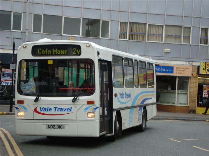 GHA Coaches Wright Handybus bodied Dennis Dart in Wrexham in March 2009