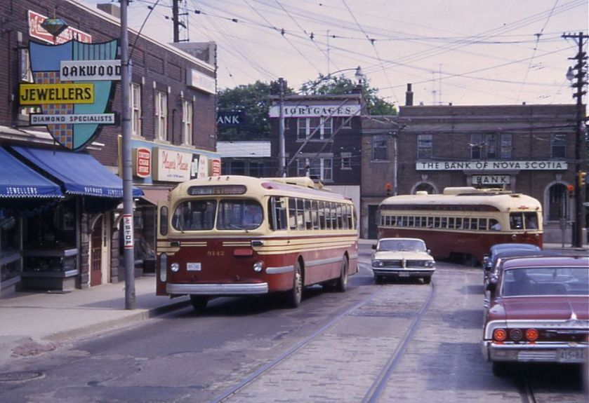 Toronto_CCF-Brill_trolleybus_passing_PCC_streetcar_on_Oakwood_St,_1968