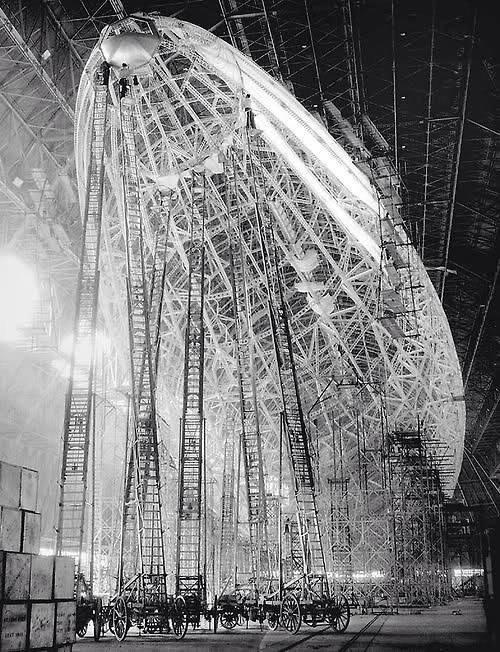 Magirus ladders in use on the construction of a rigid airship. (Notice men at the very top of several ladders.)