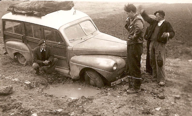 1941 Mercury Eight station wagon - stuck in the mud with race car designer John Crosthwaite (standing)