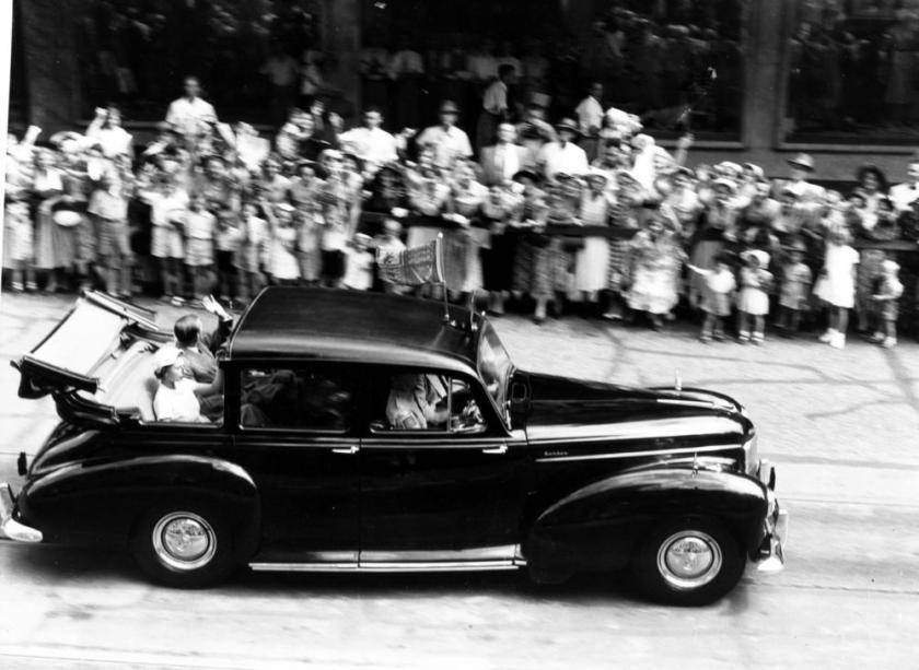 1954 Queen Elizabeth II and Prince Philip wave to the crowds from a Humber car during their visit to Brisbane in 1954