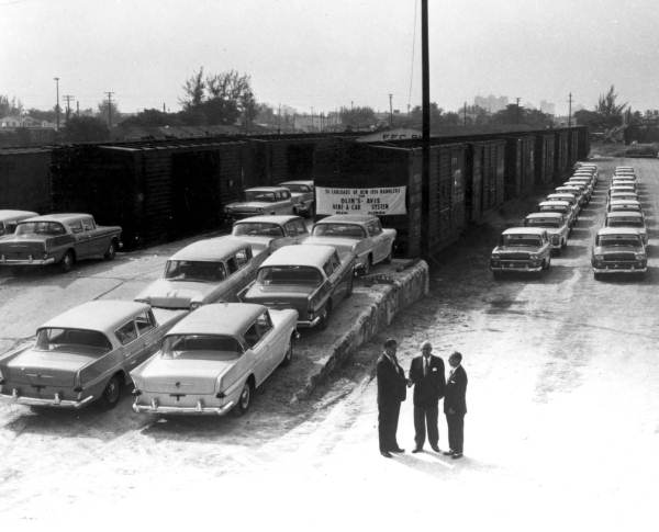1958 Train unloading 1958 Ramblers for a car rental company in Florida.