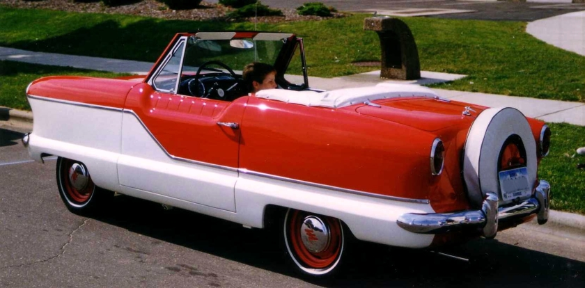 1959 Metropolitan convertible by AMC (American Motors Corporation) finished in two-tone red and white. Rear View.