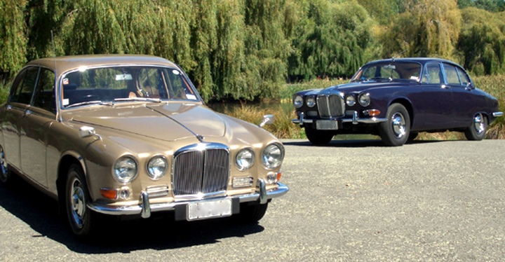 1968 Jaguar 420 (gold) and 1967 Daimler Sovereign (blue)
