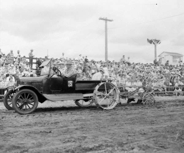 A Model T homemade tractor pulling a plow