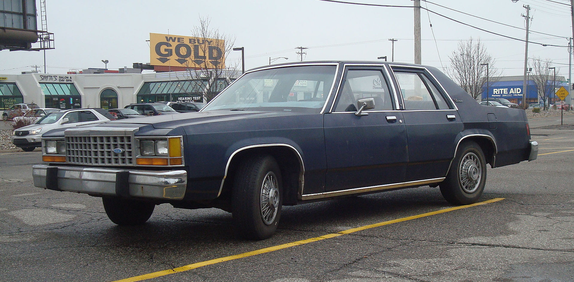 1983–1987 Ford LTD Crown Victoria S with vinyl roof delete.