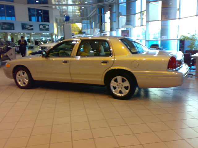 2008 Ford Crown Victoria P70 (Standard Long Wheelbase) at a dealership in Kuwait.