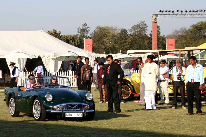 Daimler SP250 Dart driving up to the podium to collect the class award