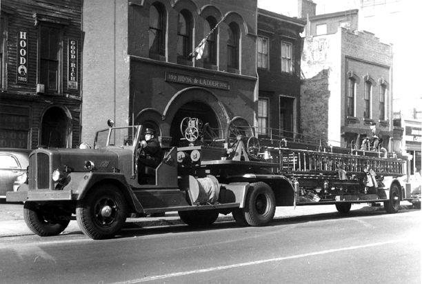 1947 Ward LaFrance tractor, 1931 American LaFrance 75' ladder