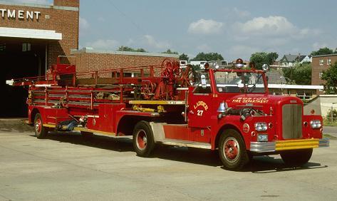 1963 Ward LaFrance tractor on a 1950 ALF 85' wood aerial ladder truck