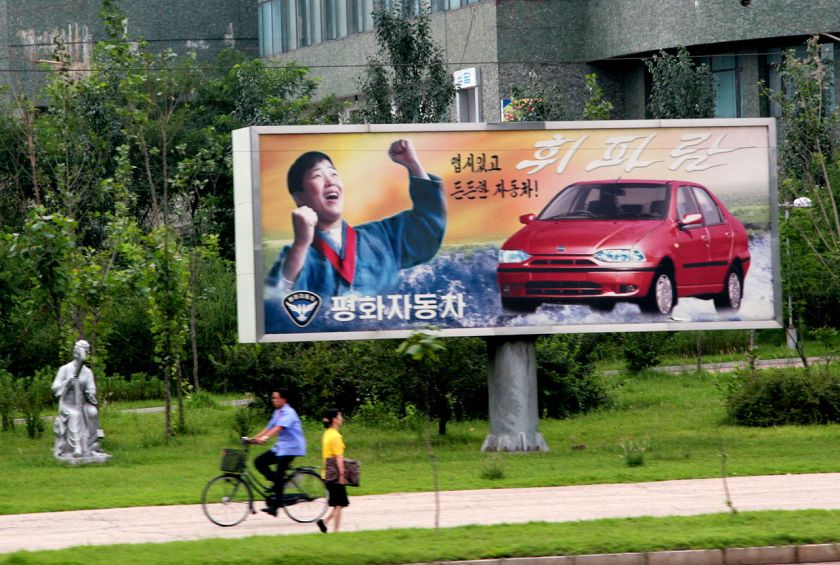 Pyonghwa Motors billboard showing the Hwiparam.