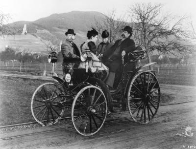 1894 Karl and Bertha Benz, their daughter Clara and Fritz Held on a Benz Viktoria