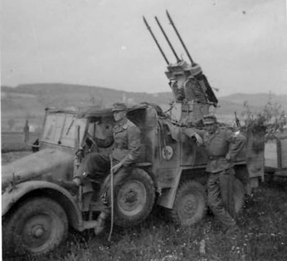 1940 German Krupp protze L 2 H 143 with a triple AA anti-aircraft gun.