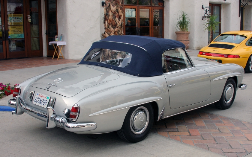 A 1962 Mercedes-Benz 190 SL fitted with softtop