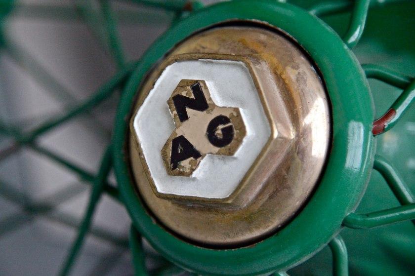 1913 NAG Rennsportwagen wheel hub emblem.