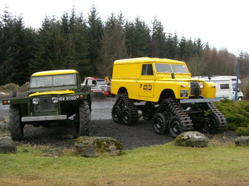 1961-1966 Forest Land Rover (on the left)