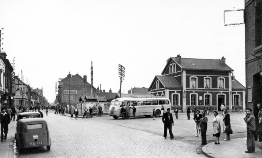 1952 The station at Billy Montigny showing a Delahaye bus at the railway station.