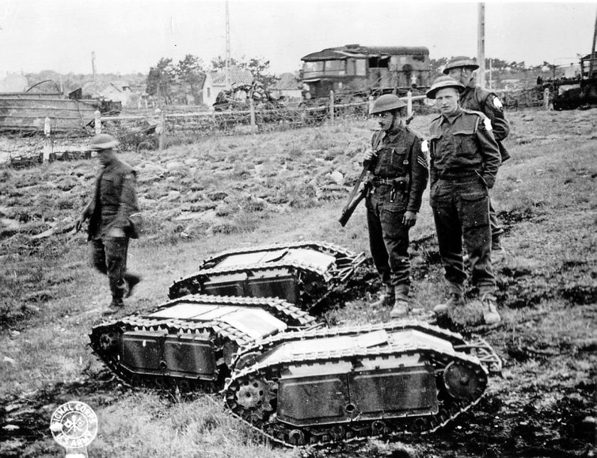 British soldiers with captured German Goliath tracked mines.