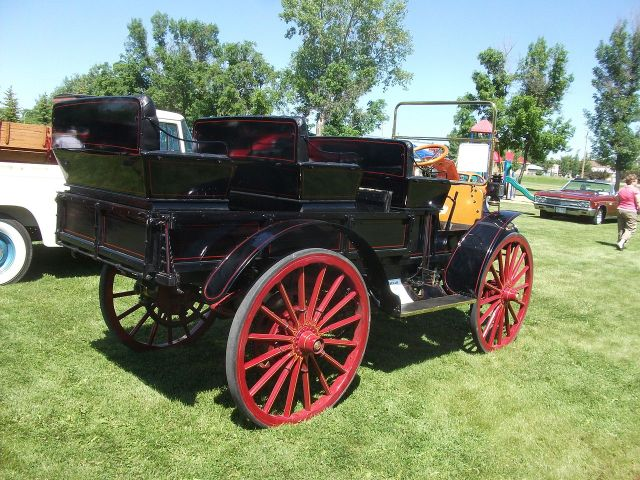 1913 International MW. It is powered by a two cylinder engine rearside