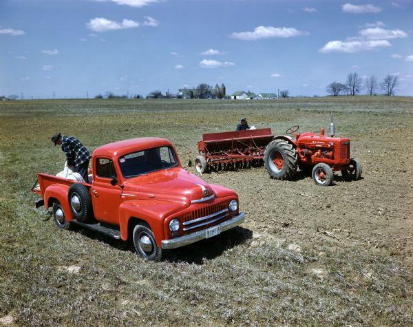 1950 International L-120 truck, W-4 tractor and grain drill