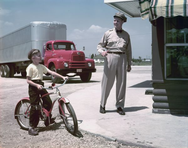 1950 International Truck Driver Talking with a Boy on a Bike