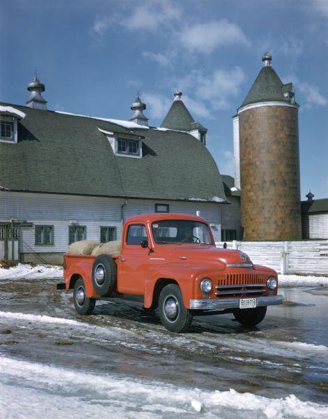 1950 International truck loaded with sacks