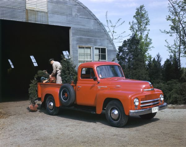 1950 Loading trees into an International L-120 truck