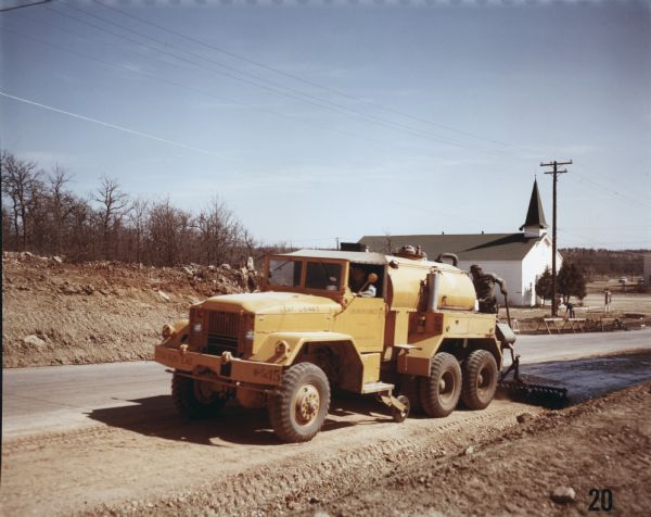 1952 International M-61 to spread asphalt at Wolters Air Force Base