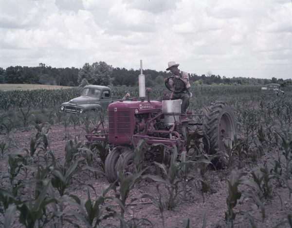 1952 Man Using Super C Tractor with Cultivator