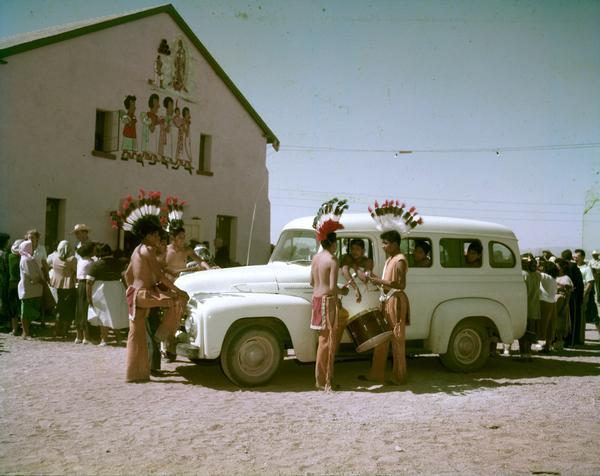 1953 American-Indian Youth Fathered Around International truck