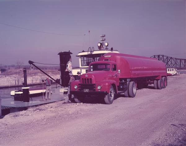 1953 International Model RP-195 roadliner truck with attached trailmobile oil tanker.