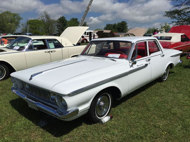 1962 Plymouth Belvedere four-door sedan finished in white with red interior