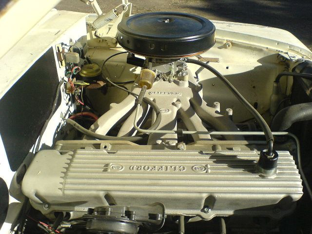 1962 Plymouth Valiant This is a 4 bbl Slant-6 Hyper-Pak reproduction by Clifford Performance in a 1962 Plymouth Valiant.