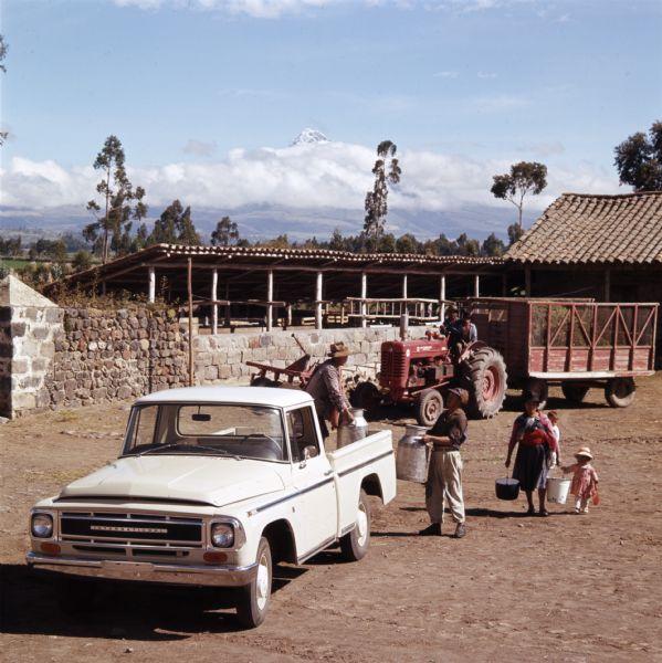 1965 Loading Milk On to International Truck