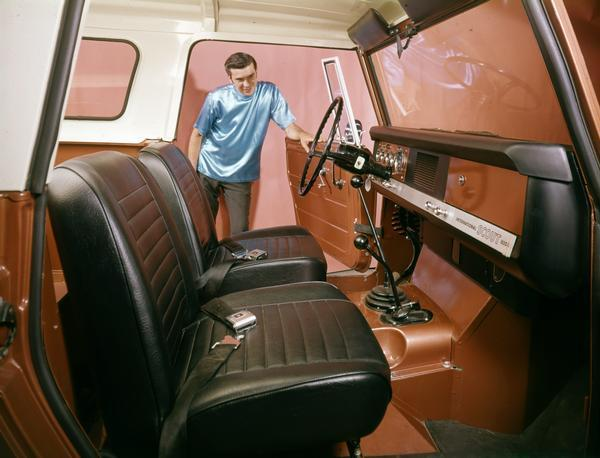 1968 Man Inspects Interior of International Scout 800A Pickup