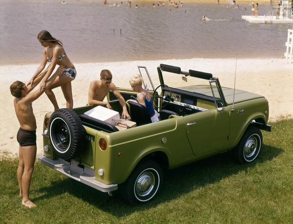 1969 International Scout pickup truck near a public beach