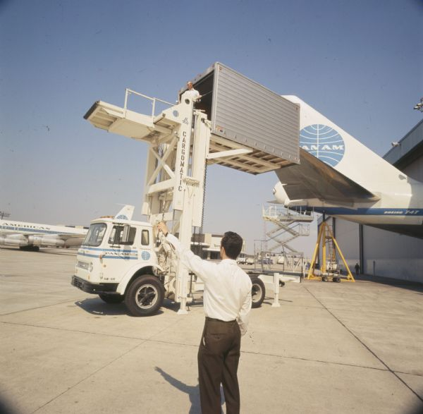 1970 International truck carrying prepacked airline food to Pan American World Airways Boeing 747 airplane