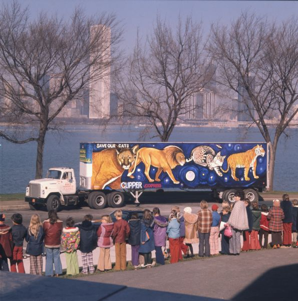 1975 Children Looking at Save Our Cats Mural on Trailer