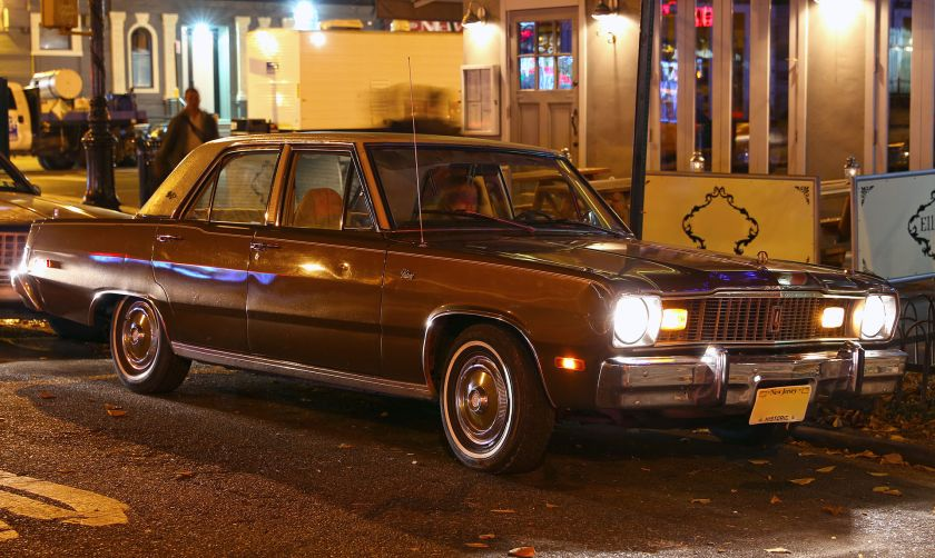 1975 Plymouth Valiant Brougham in brown, by night