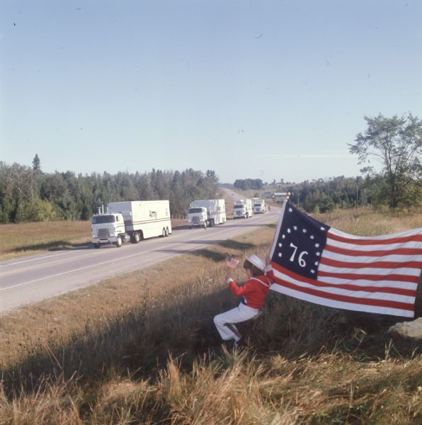 1975 Seven-year-old LuRae Criscione watches the International Harvester United States Armed Forces Bicentennial Caravan
