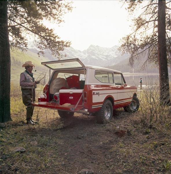 1976 Fisherman Unloads Gear from International Scout II Pickup