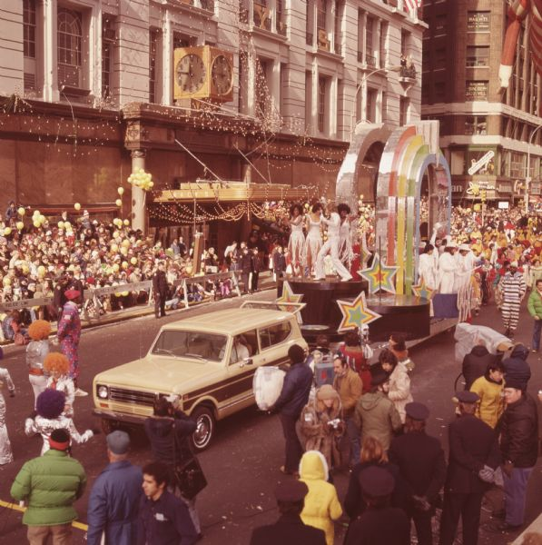 1976 International Scout Truck Towing Colorful Float in Parade