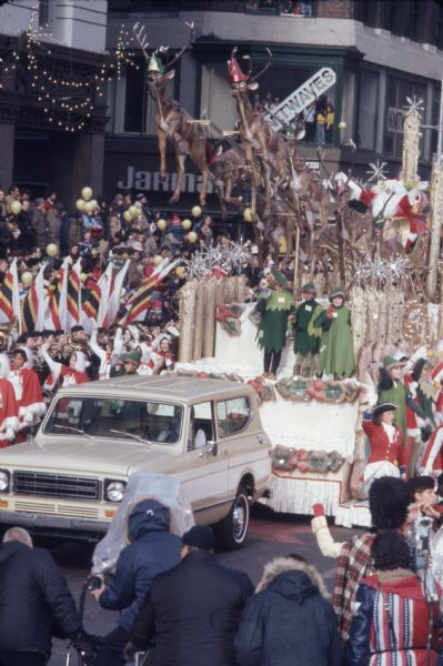 1976 white International Harvester Scout 4x4 is pulling a float with a Santa Claus theme